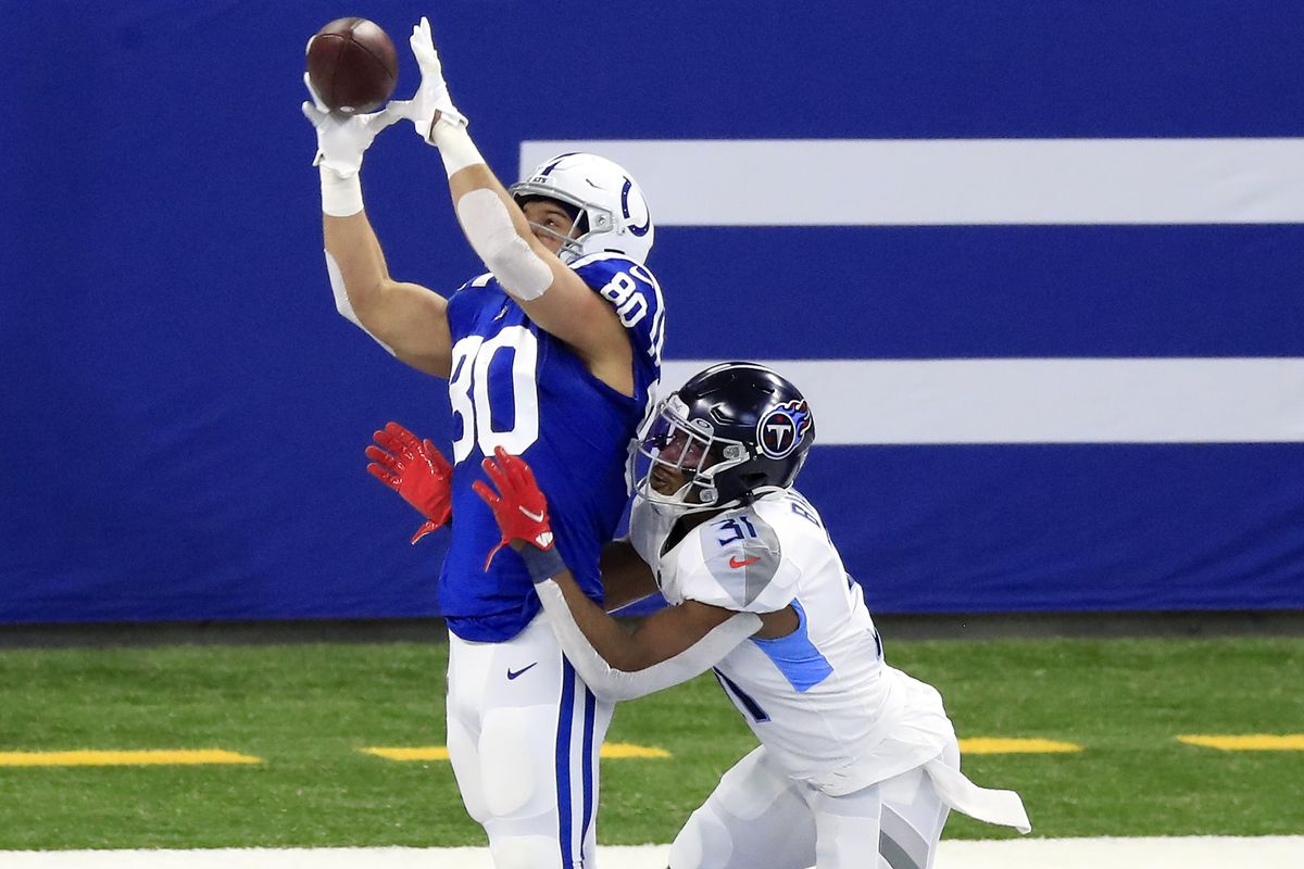 Trey Burton #80 of the Indianapolis Colts brings in a touchdown pass in the first quarter against Kevin Byard #31 of the Tennessee Titans during their game at Lucas Oil Stadium on November 29, 2020 in Indianapolis, Indiana.
