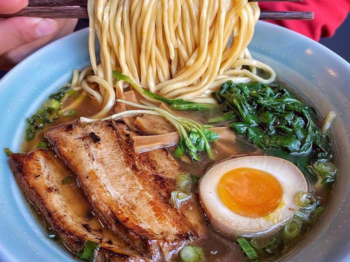 Ramen noodles swirling around chopsticks