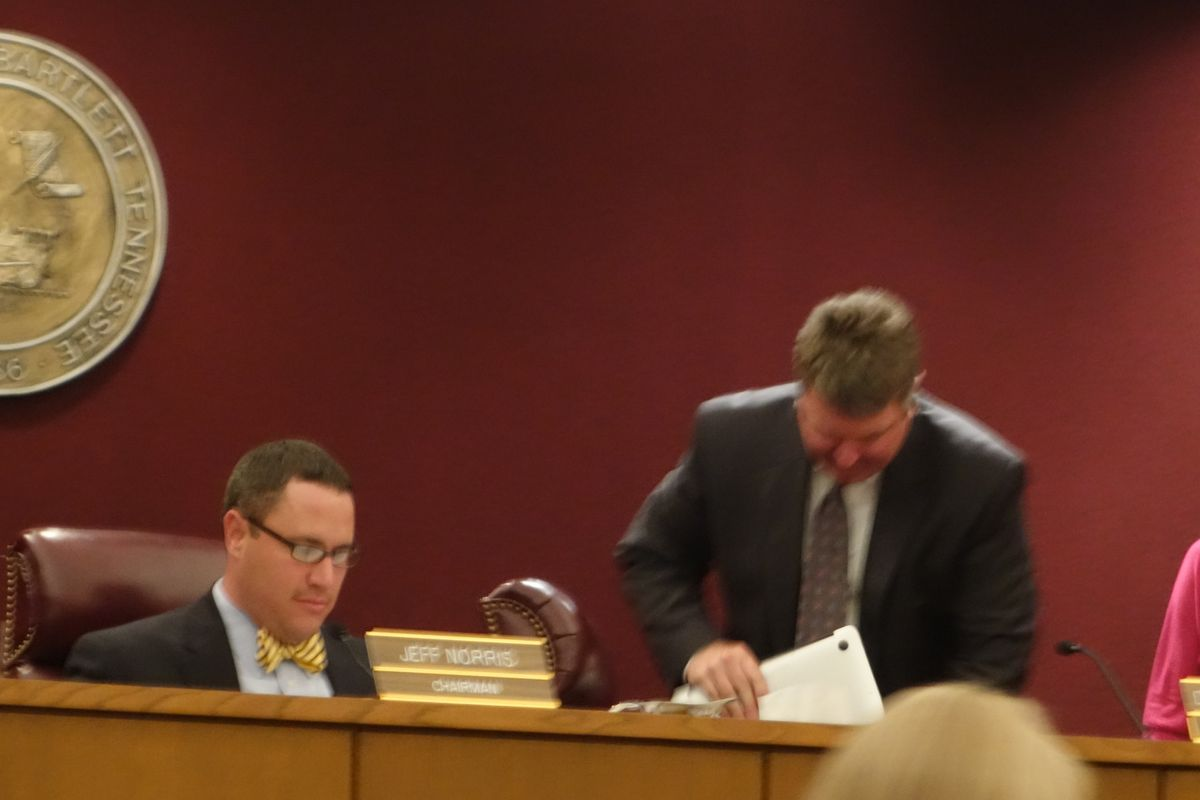 Bartlett Superintendent David Stephens (center) packs up after a busy working board meeting.