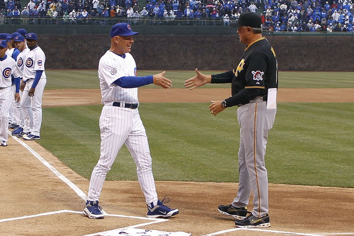 Mike Quade Manager of the Chicago Cubs shakes hands with Clint Hurdle Manager of the Pittsburgh Pirates during player introductions on opening day at Wrigley Field on April 1, 2011 in Chicago, Illinois.  (Photo by Gregory Shamus/Getty Images)