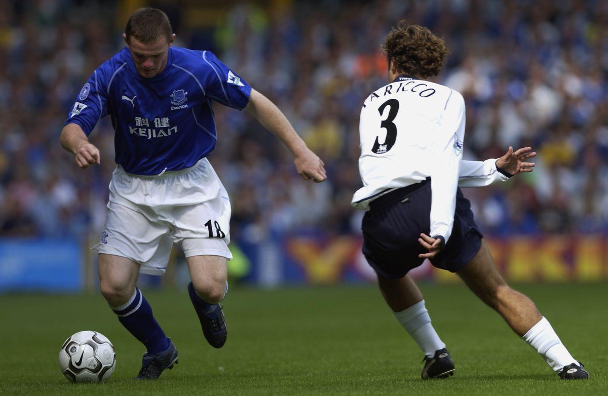 Wayne Rooney of Everton and Mauricio Taricco of Tottenham Hotspur
