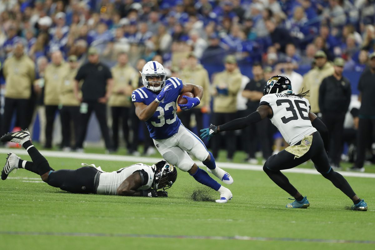 Indianapolis Colts running back Jonathan Williams runs with the ball against Jacksonville Jaguars safety Ronnie Harrison during the second quarter at Lucas Oil Stadium.