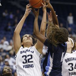 Brigham Young Cougars forward Kalani Purcell (32) grabs rebound over San Diego Toreros guard Malina Hood (11) in Provo Thursday, Feb. 18, 2016. BYU won 68-60 to capture the West Coast Conference championship.