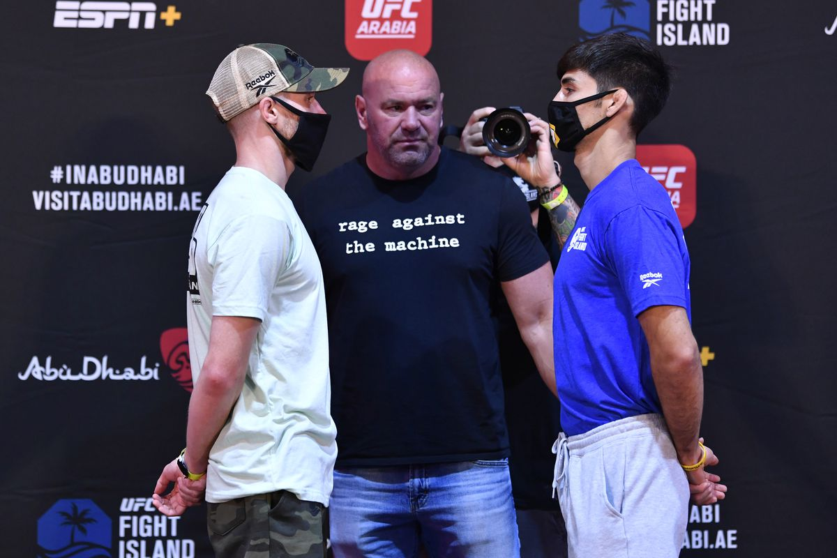 Opponents Jack Shore of Wales and Aaron Phillips face off during the UFC Fight Night weigh-in inside Flash Forum on UFC Fight Island on July 14, 2020 in Yas Island, Abu Dhabi, United Arab Emirates.