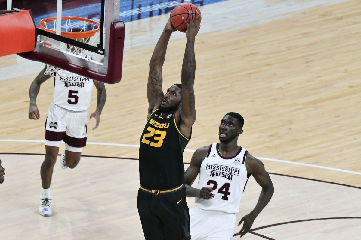 Missouri Tigers forward Jeremiah Tilmon goes up for a shot while defended by Mississippi State Bulldogs forward Abdul Ado during the first half at Humphrey Coliseum.
