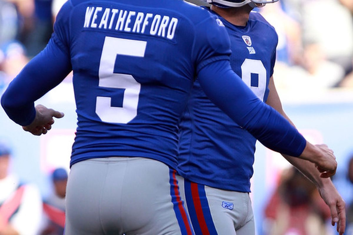 Steve Weatherford (5) of the New York Giants celebrates the winning field goal with Lawrence Tynes (9) against the Buffalo Bills at MetLife Stadium on October 16, 2011 in East Rutherford, New Jersey.  (Photo by Nick Laham/Getty Images)