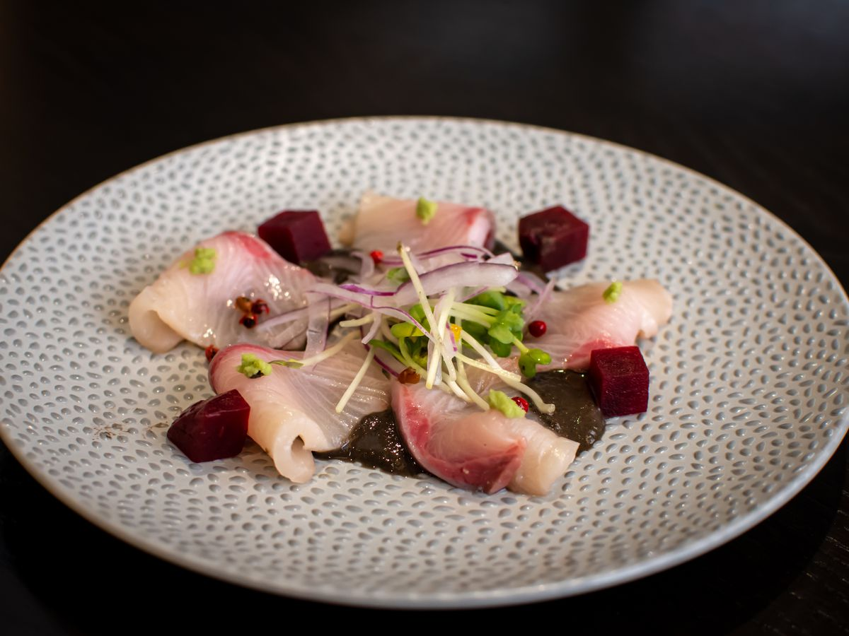A plate of yellowtail crudo from Kaz Sushi Bistro