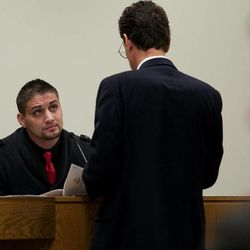 Defense attorney Randy Spencer, right, questions Jason Poirier, a former inmate who served time with Martin MacNeill, during MacNeill's trial at 4th District Court in Provo Wednesday, Nov. 6, 2013. MacNeill is charged with murder for allegedly killing his wife, Michele MacNeill, in 2007.