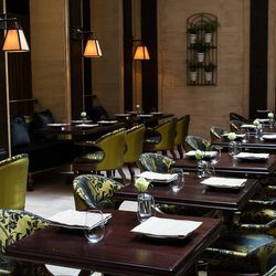 """<b>The Nomad</b> is filled with all sorts of over-stuffed chairs, but some of them, like the ones in the Parlor and the Library, don't have arms.  If you're  a comfortable chair lover, the Atrium is where you want to sit.   (<a href=""""http://nycfoodphotogr"""