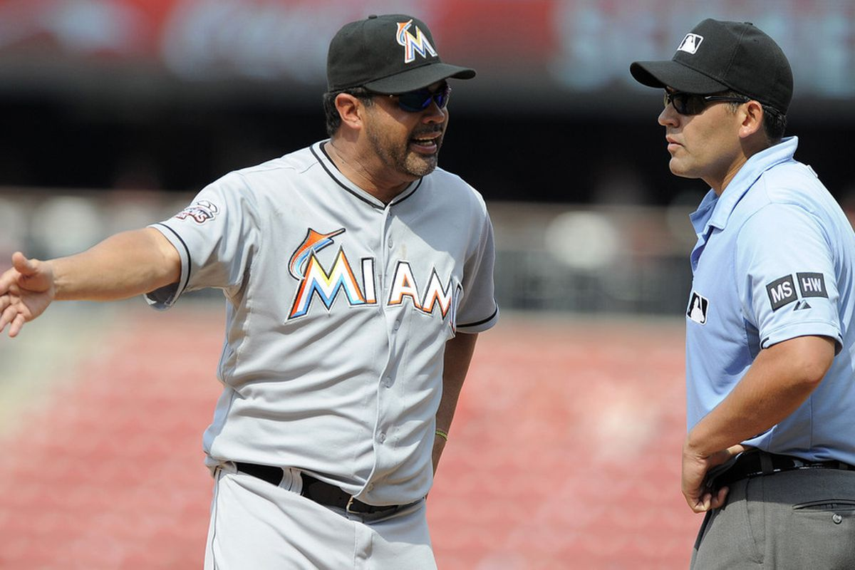 July 8, 2012; St. Louis, MO. USA; Miami Marlins manager Ozzie Guillen (13) argues with umpire Manny Gonzalez (79) in the ninth inning against the St. Louis Cardinals at Busch Stadium. The Cardinals won 5-4. Mandatory Credit: Jeff Curry-US PRESSWIRE