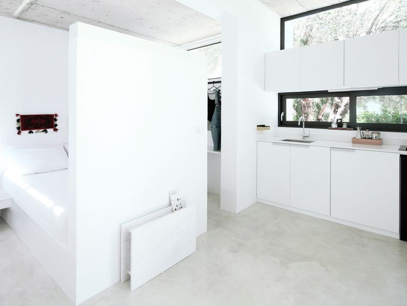 Inside of house with white cabinets and wall.