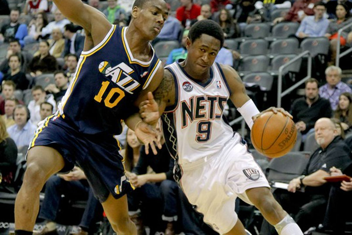 Mar 26, 2012; Newark, NJ, USA;  New Jersey Nets guard MarShon Brooks (9) drives to the basket as Utah Jazz guard Alec Burks (10) defends during the first half at the Prudential Center. Mandatory Credit: Jim O'Connor-US PRESSWIRE
