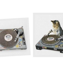 """<a href=""""http://www.urbanoutfitters.com/urban/catalog/productdetail.jsp?id=26870907"""">Cat DJ Scratch Desk</a>', $40 at Urban Outfitters."""