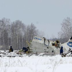 Russian Emergency Ministry rescuers search the site of the ATR-72 plane crash outside Tyumen, a major regional center in Siberia, Russia, Monday, April 2, 2012. A passenger plane crashed in Siberia shortly after taking off on Monday morning, killing 32 of the 43 people on board, Russian emergency officials said. The 11 survivors were hospitalized in serious condition. The ATR-72, a French-Italian-made twin-engine turboprop, operated by UTair was flying from Tyumen to the oil town of Surgut with 39 passengers and four crew.