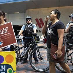 Immigrant rights activists protest outside the Marriott Marquis Chicago on Tuesday while U.S. Customs and Border Protection hosts its 2019 Trade Symposium.