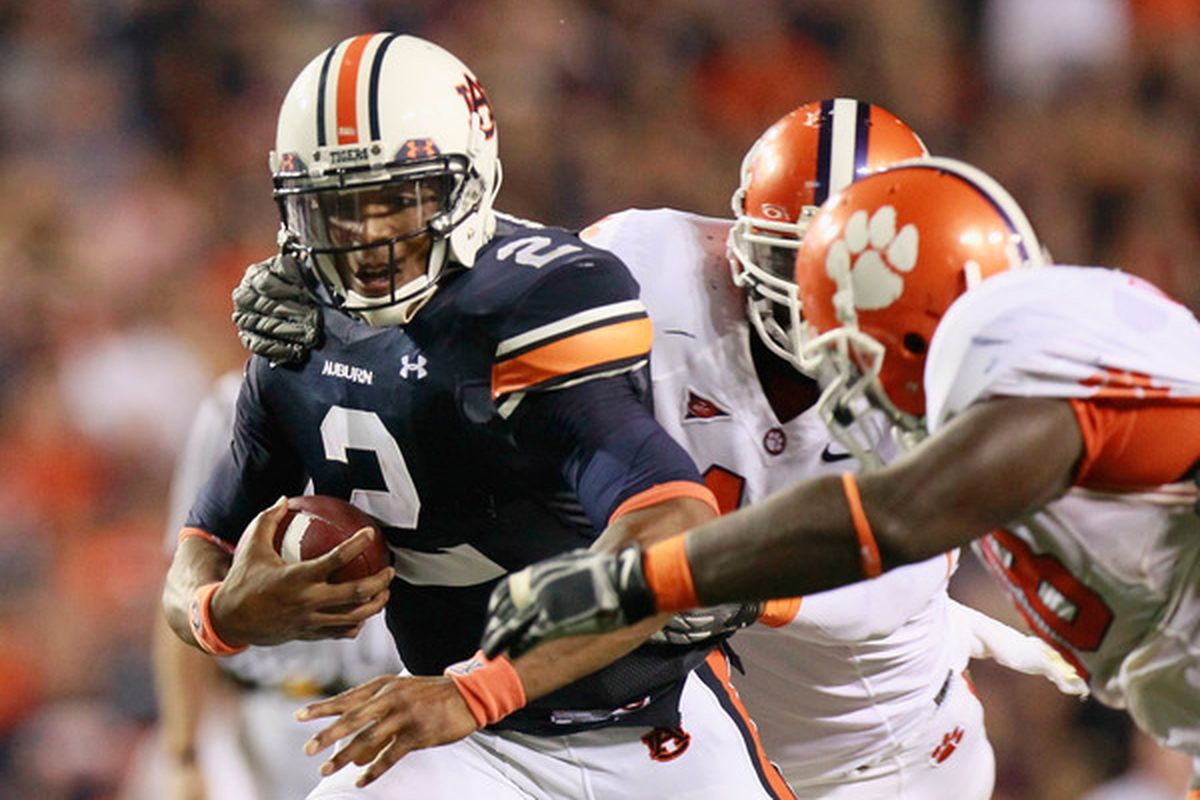 AUBURN AL - SEPTEMBER 18:  Quarterback Cameron Newton #2 of the Auburn Tigers rushes upfield in overtime against the Clemson Tigers at Jordan-Hare Stadium on September 18 2010 in Auburn Alabama.  (Photo by Kevin C. Cox/Getty Images)