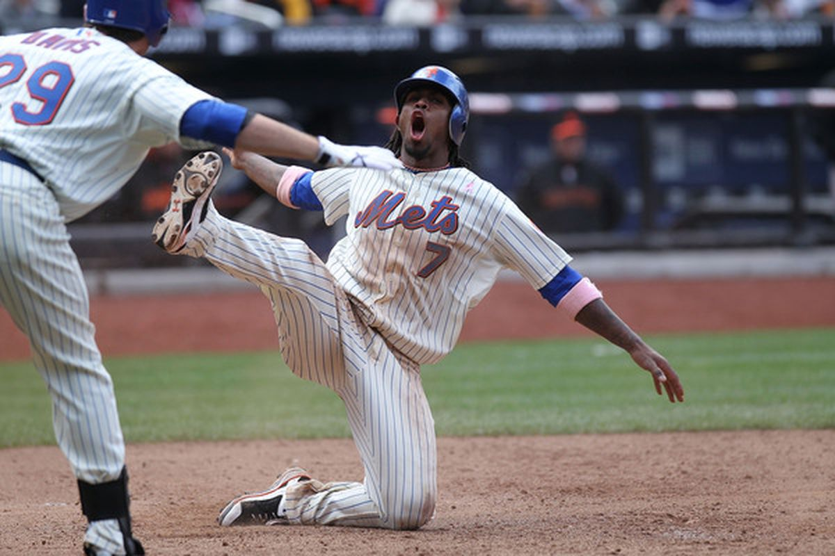 The sweet ballet of sliding home.  (Photo by Nick Laham/Getty Images)