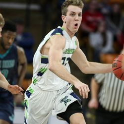 Ridgeline's Jaxon Brenchley drives down court against Juan Diego in the 3A boys basketball state championship at the Dee Glen Smith Spectrum in Logan on Saturday, Feb. 25, 2017.
