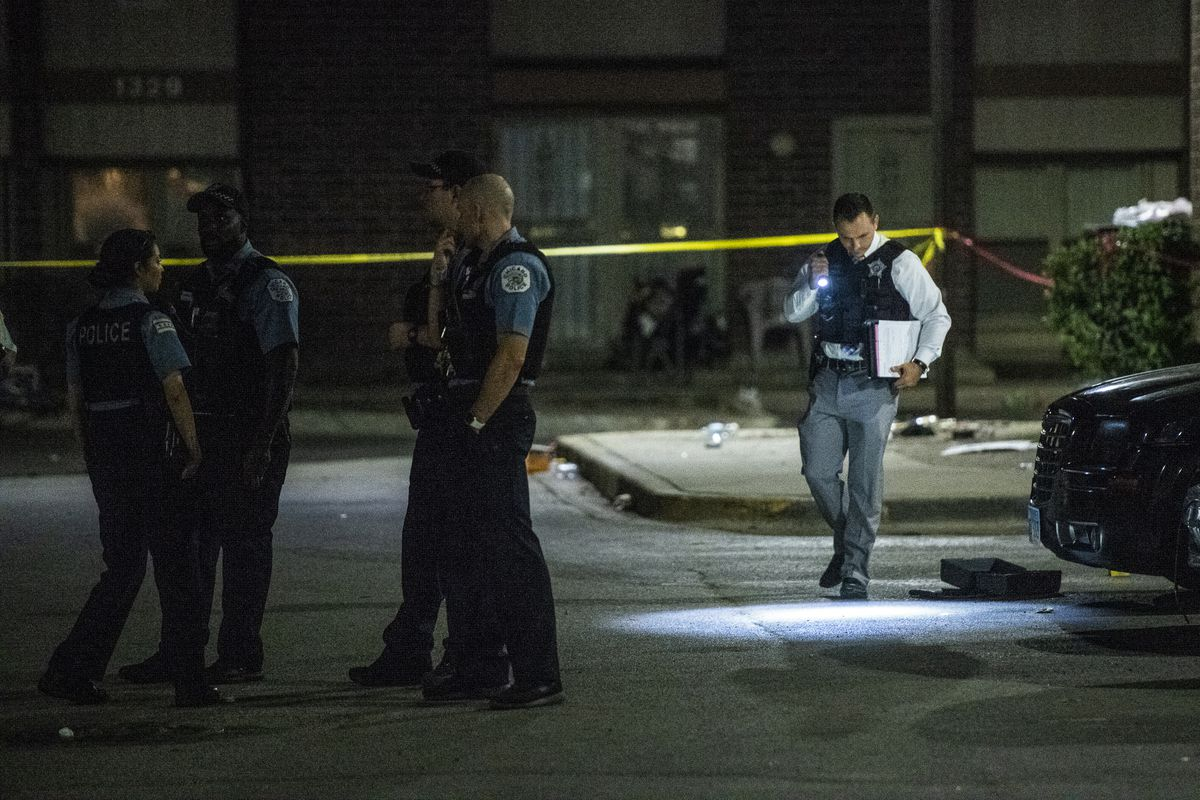 Police investigate the scene where multiple people were shot Sunday morning in the 1300 block of West 76th Street. | Tyler LaRiviere/Sun-Times