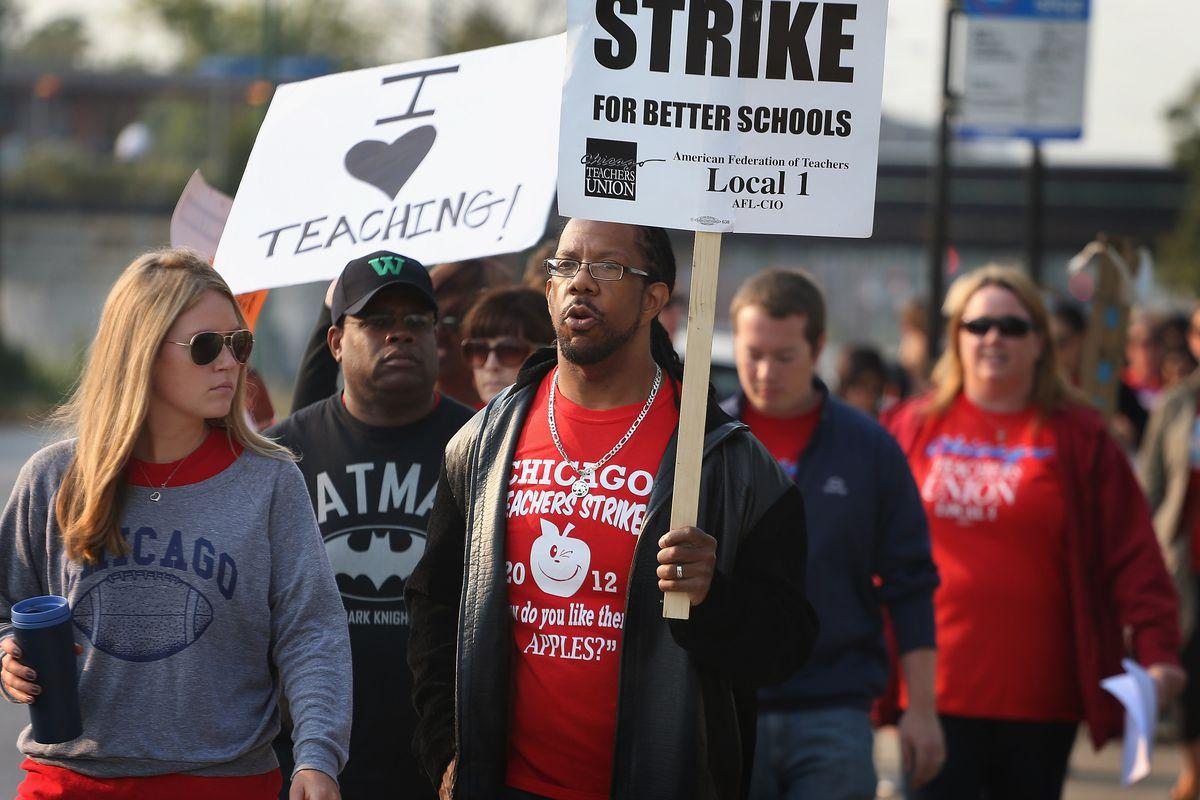 Striking Chicago public school teachers picket outside of George Westinghouse College Prep high school in 2012.