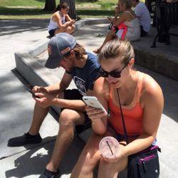 Matthew Dyer, left, and Rachel Gitlin play Pokemon Go at Liberty Park Sunday afternoon.