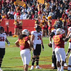 Kamilo Tongamoa (48), Jamahl Johnson (92) and Marcel Spears Jr. (42) wait for the next play while Jack Anderson (56) and Paul Stawarz (76) do the same.