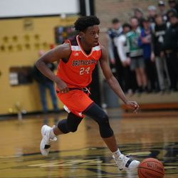 Brother Rice's Marquise Kennedy (24) grabs a rebound and pushes the ball down court, Tuesday 02-19-19. Worsom Robinson/For the Sun-Times.