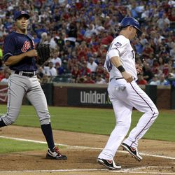 Cleveland Indians' Ubaldo Jimenez watches as Texas Rangers' Michael Young scores on a wild pitch by Jimenez in the second inning of a baseball game Tuesday, Sept. 11, 2012, in Arlington, Texas.