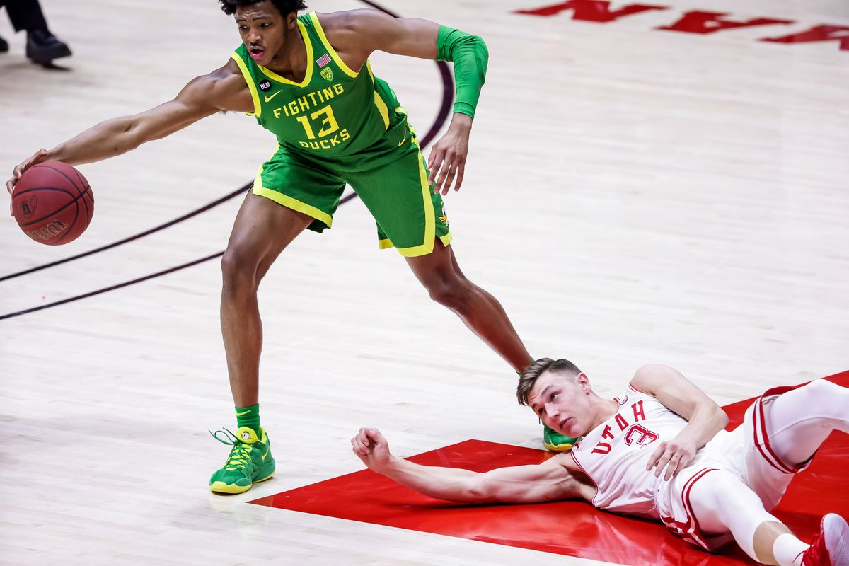 Oregon Ducks forward Chandler Lawson (13) grabs the ball as Utah Utes guard Pelle Larsson (3) hits the boards during the game at the Huntsman Center in Salt Lake City on Saturday, Jan. 9, 2021.