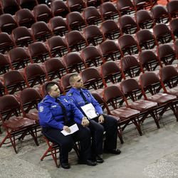 Transportation Security Administration supervisory officers Danielle Arocho, left, and Lisandro Jimenez hold hands as they listen to a song after a public memorial service for TSA officer Gerardo Hernandez, who was killed by a rampaging gunman at the Los Angeles International Airport, on Tuesday, Nov. 12, 2013, in Los Angeles. Hundreds of colleagues of Hernandez celebrated his life Tuesday at an emotional service that included prayers, song and memories of a cheerful man who colleagues said cherished his family.