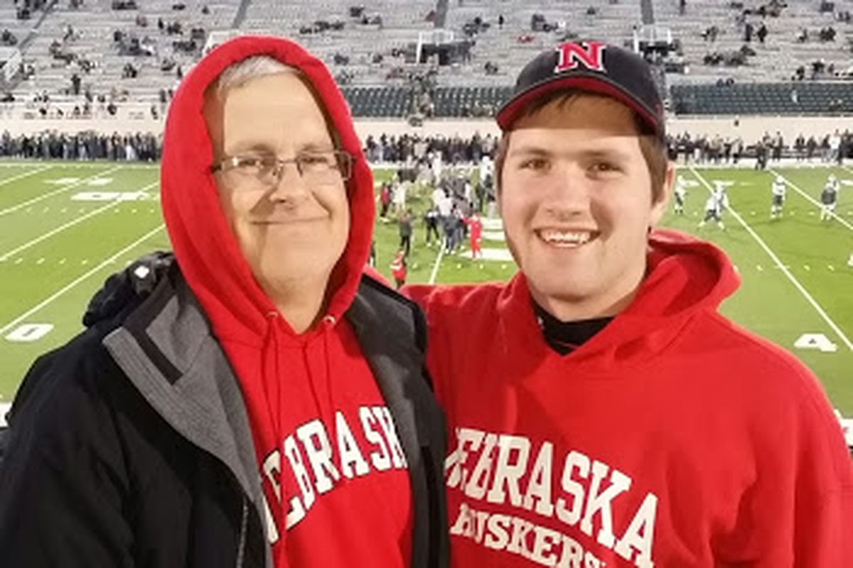 Keith and his dad at a Husker game.