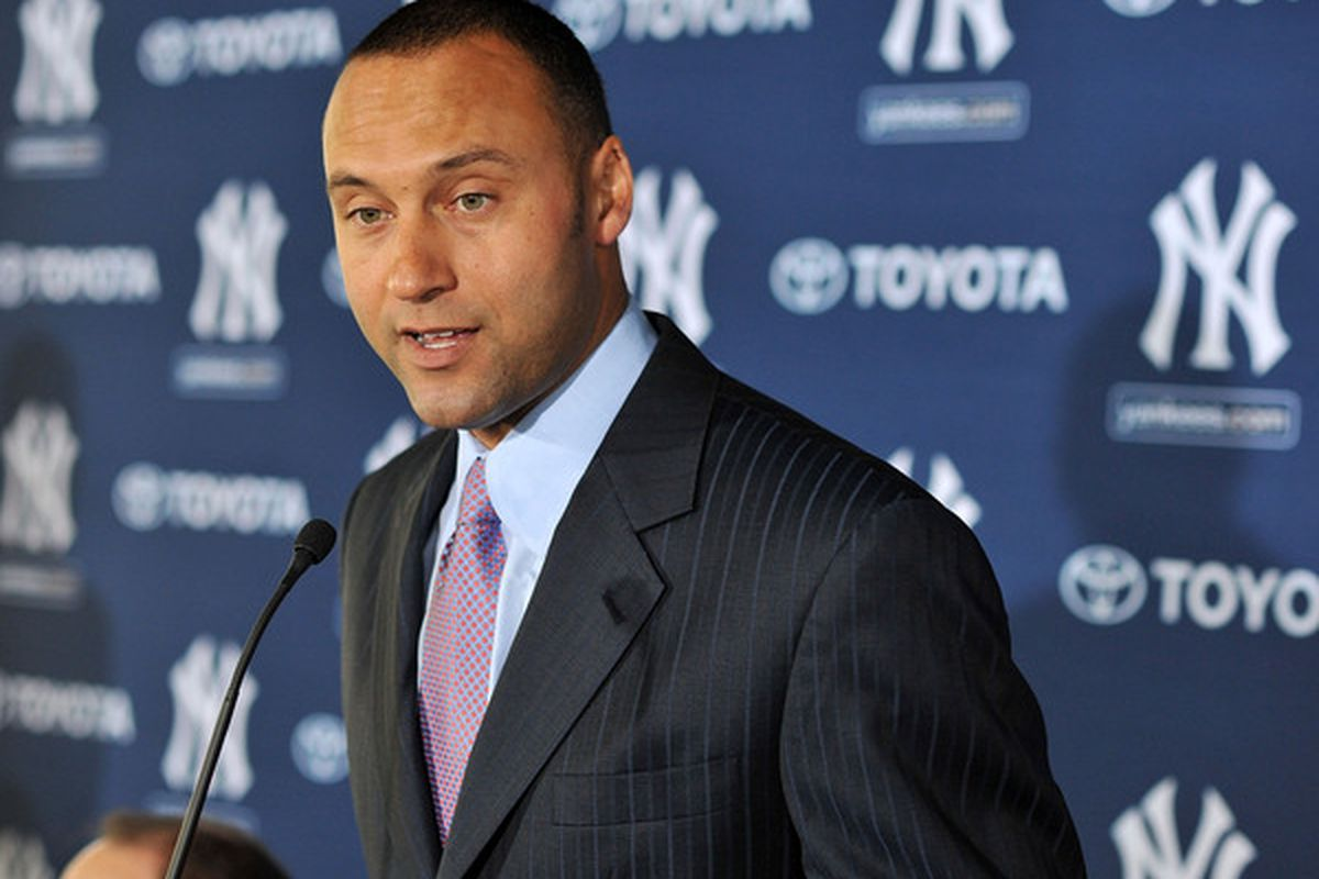 TAMPA FL - DECEMBER 07:   Shortstop Derek Jeter of the New York Yankees talks to the media during a press conference to announce his new contract with the club on December 7 2010 in Tampa Florida.  (Photo by Tim Boyles/Getty Images)