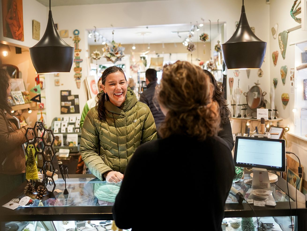 Salt Lake City Mayor-elect Erin Mendenhall talks to Gail Piccoli, owner of Commerce & Craft, right, while making a purchase at the shop during a Small Business Saturday event in Salt Lake City on Saturday, Nov. 30, 2019.