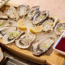 """Oysters from Sik Gaek by <a href=""""http://www.flickr.com/photos/chris6sigma/5929283030/in/pool-eater/"""">ExFlexitarian</a>."""