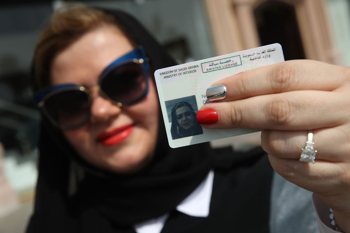 Nada Edlibi holds up her Saudi Arabian driver's license on the first day that she is legally allowed to drive in Saudi Arabia on June 24, 2018 in Jeddah, Saudi Arabia.