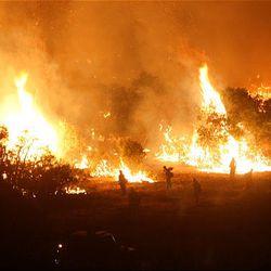 Firefighters battle a fire in New Harmony.