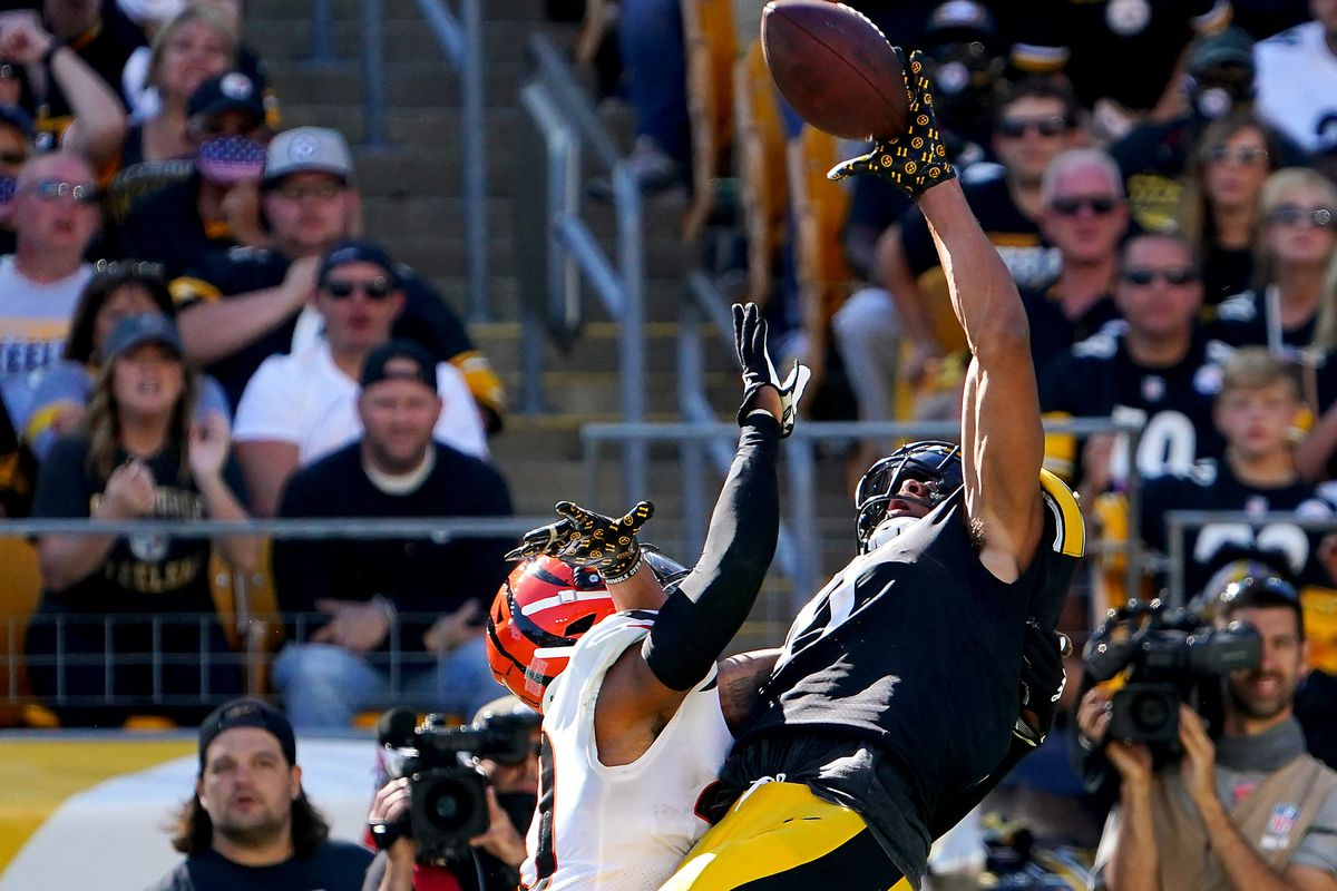 Cincinnati Bengals cornerback Mike Hilton (21) is called for pass interference as Pittsburgh Steelers wide receiver Chase Claypool (11) goes up for a catch in the fourth quarter during a Week 3 NFL football game, Sunday, Sept. 26, 2021, at Heinz Field in Pittsburgh.