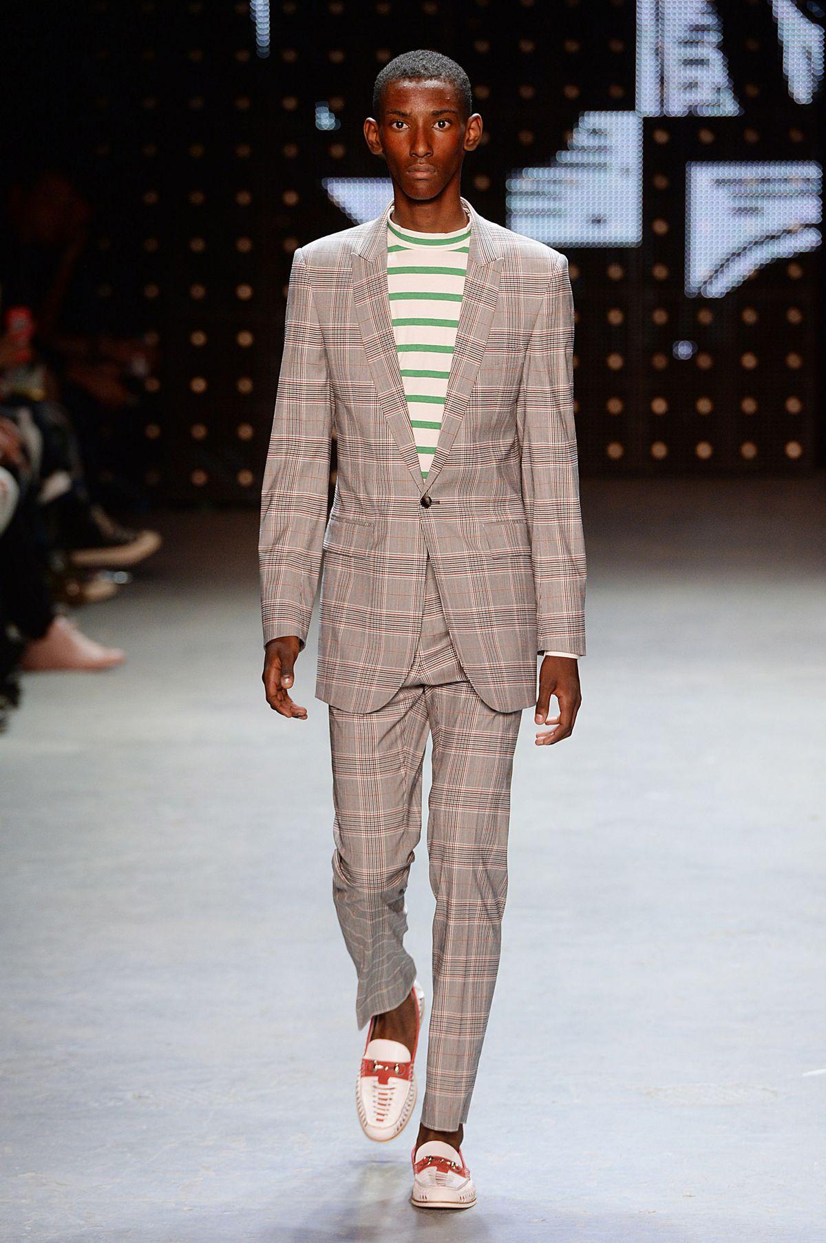 Male model walking runway for Topman