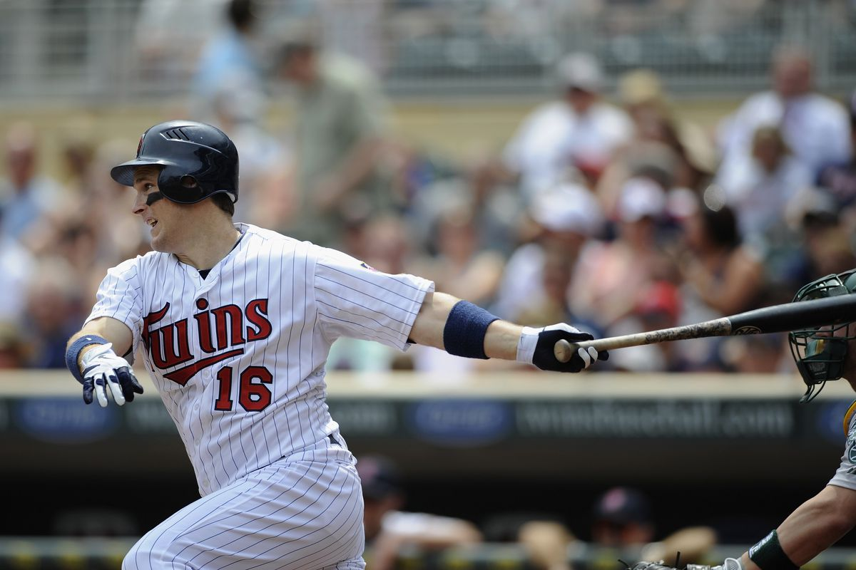 MINNEAPOLIS, MN - JULY 15: Josh Willingham #16 of the Minnesota Twins hits into a fielders choice during the first inning against the Oakland Athletics on July 15, 2012 at Target Field in Minneapolis, Minnesota. (Photo by Hannah Foslien/Getty Images)