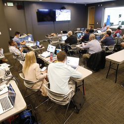 Utah journalists watch the NBA draft at the Zions Bank Basketball Center in Salt Lake City on Thursday, June 22, 2017.