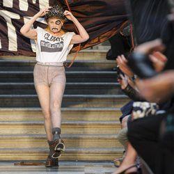 British designer Vivienne Westwood receives applause during London Fashion Week, Sunday, Sept. 16, 2012.
