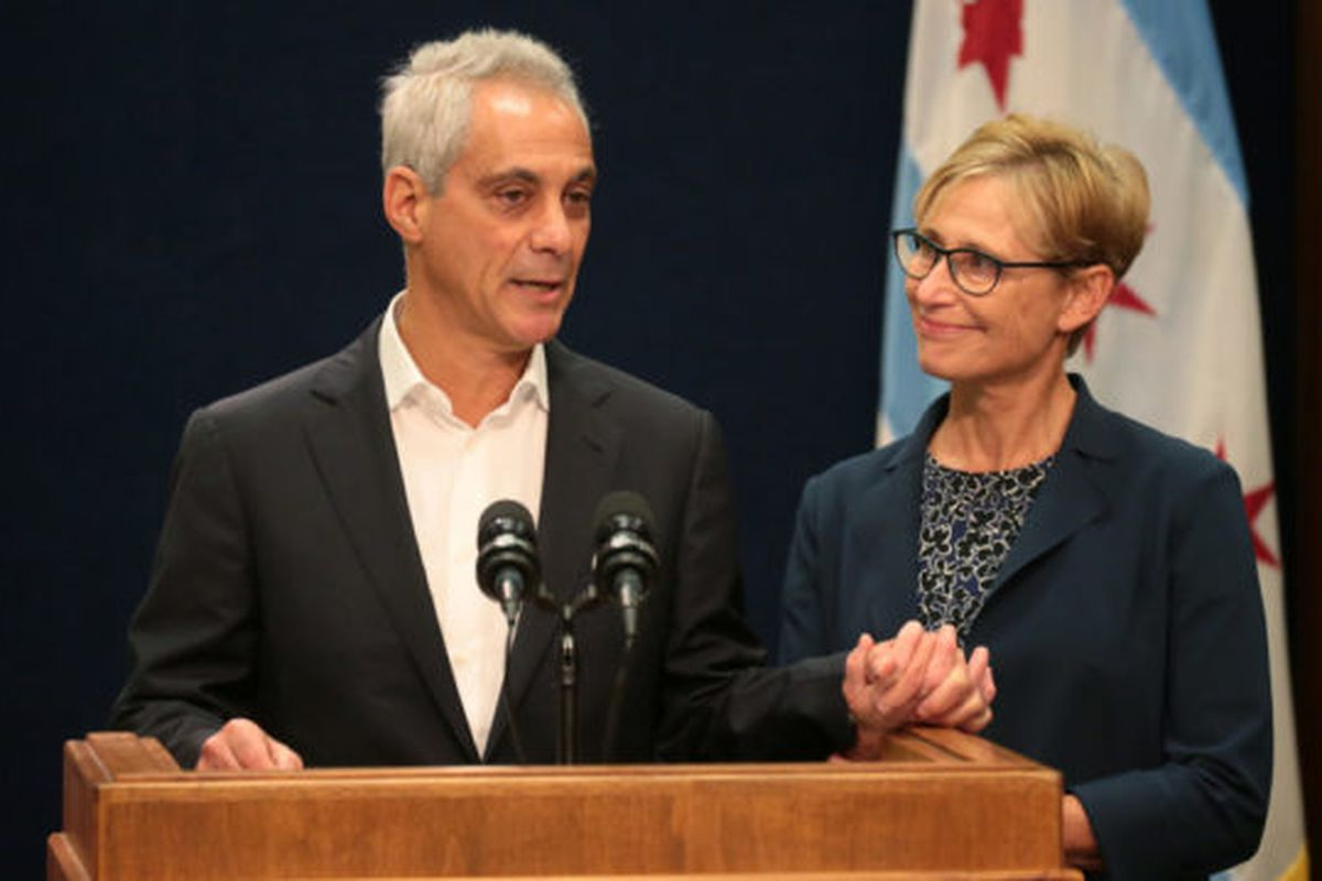 With wife Amy Rule by his side, Chicago Mayor Rahm Emanuel announces Tuesday, Sept. 4, 2018 he will not seek a third term in office at a press conference on the 5th floor at City Hall in Chicago.