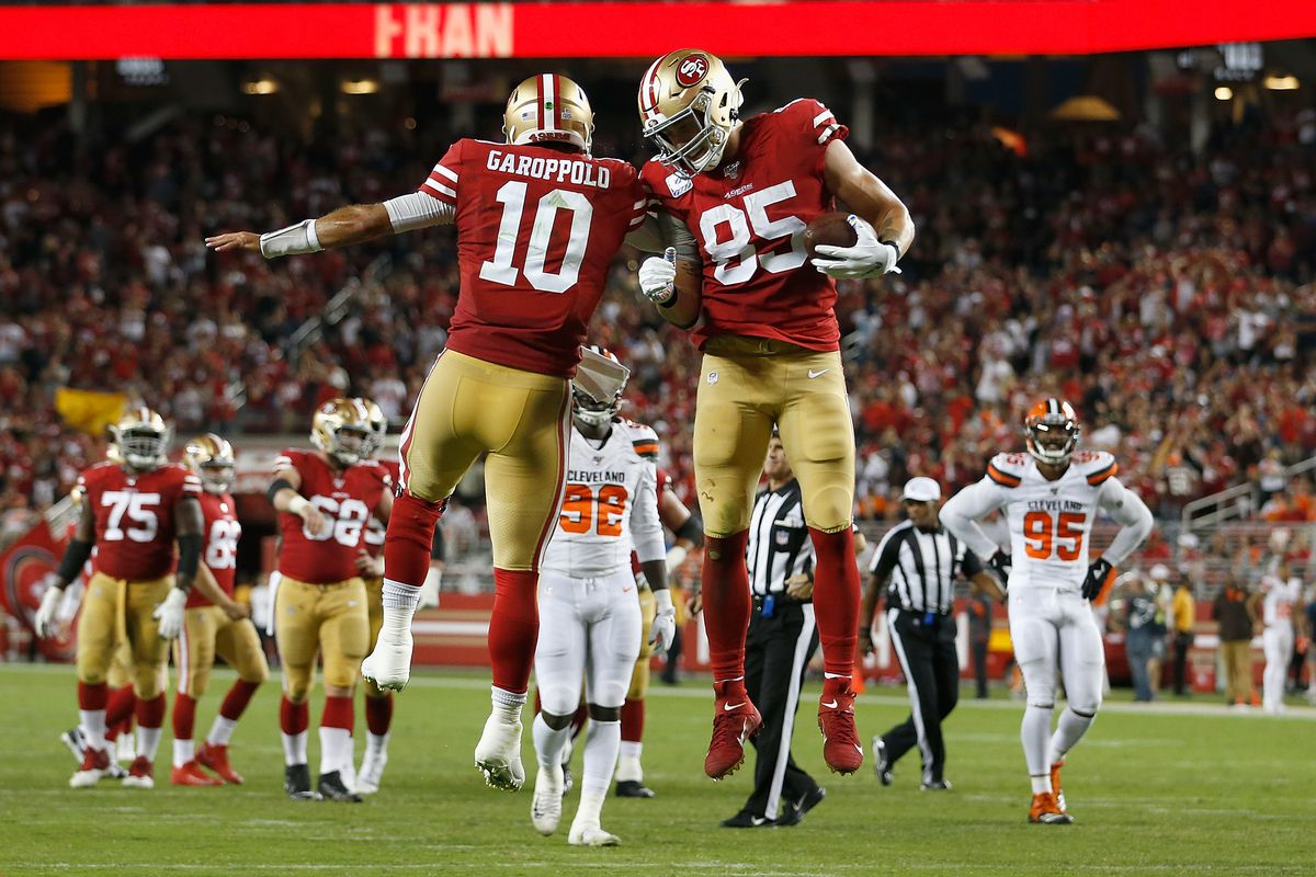 George Kittle #85 of the San Francisco 49ers celebrates with quarterback Jimmy Garoppolo #10 after scoring a touchdown in the third quarter against the Cleveland Browns at Levi's Stadium on October 07, 2019 in Santa Clara, California.