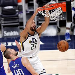 Utah Jazz center Rudy Gobert (27) dunks over LA Clippers center Ivica Zubac (40) as the Utah Jazz and LA Clippers play in an NBA basketball game at Vivint Smart Home Arena in Salt Lake City on Friday, Jan. 1, 2021. Utah won 106-100.