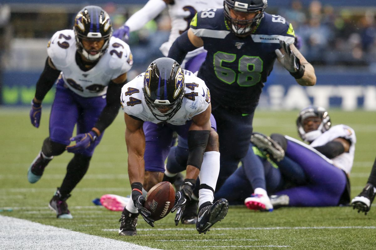 Baltimore Ravens cornerback Marlon Humphrey returns a fumble for a touchdown against the Seattle Seahawks during the fourth quarter at CenturyLink Field.