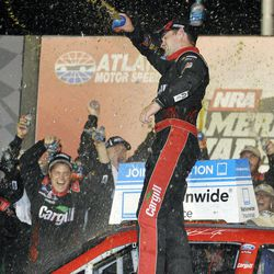Ricky Stenhouse Jr. celebrates in the victory lane after winning the NASCAR Nationwide Series auto race at Atlanta Motor Speedway, Saturday, Sept. 1, 2012, in Hampton, Ga.