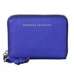 "<a href=""http://www.proenzaschouler.com/shop/small-leather-goods/zip-card-wallet-4.html?color=Purple%20Rain"">Proezna Schouler zip card wallet</a>, $295 proenzaschouler.com"