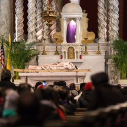 Jesus is laid on the alter at St. Adalbert Parish, 1650 W. 17th St. where a closing prayer is said. | Erin Brown/Sun-Times