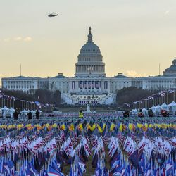 Marine One carrying President Donald Trump and first lady Melania Trump as they departed from the White House flies over the U.S. Capitol ahead of the inauguration of U.S. President-elect Joe Biden on January 20, 2021 in Washington, DC.