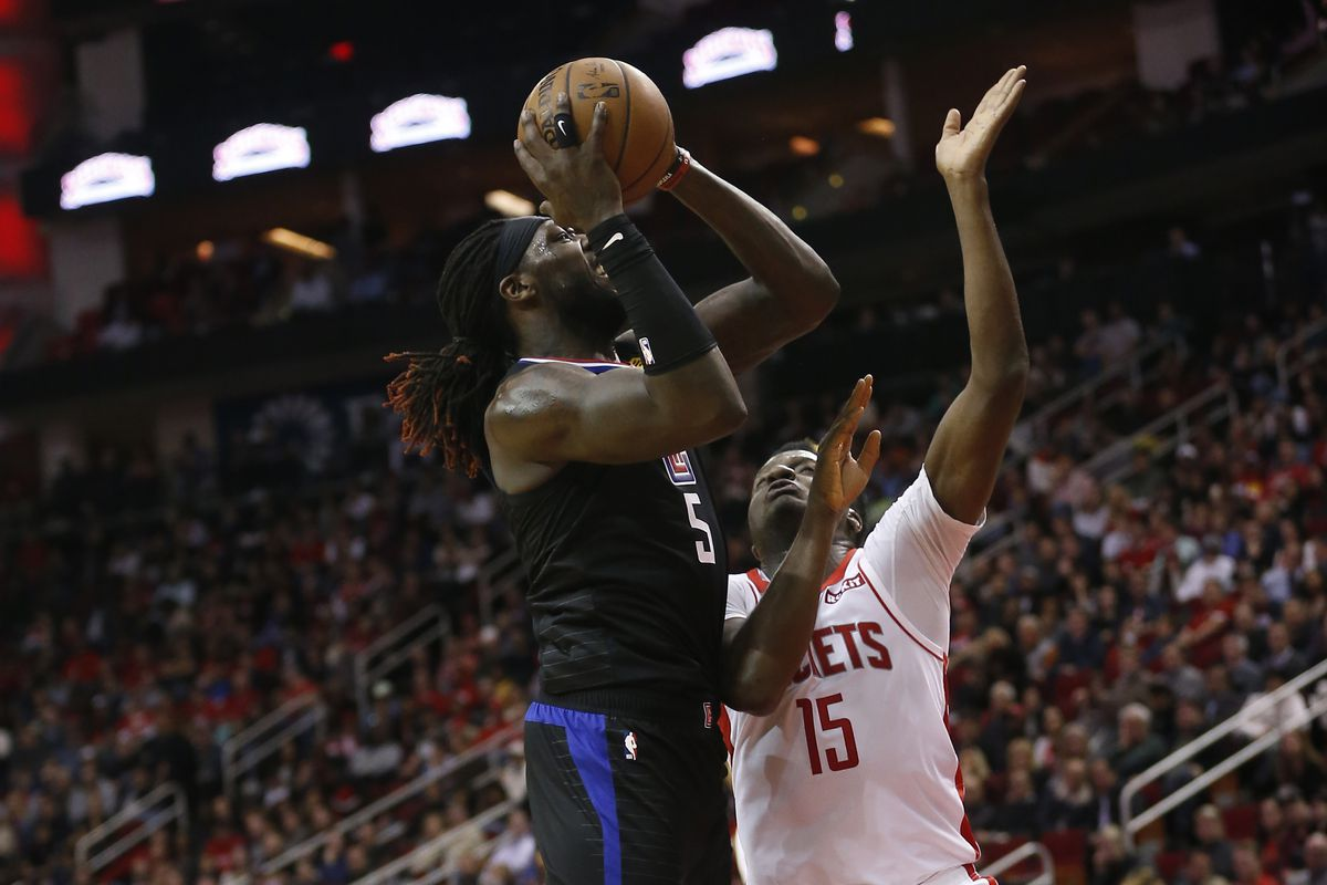 Montrezl Harrell of the Los Angeles Clippers drives to the basket on Clint Capela of the Houston Rockets during the fourth quarter at Toyota Center on November 13, 2019 in Houston, Texas.